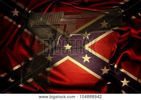 Handgun and Confederate flag