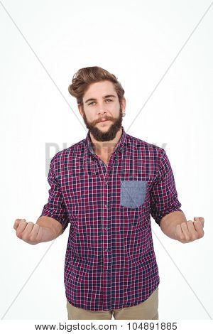 Portrait of confident hipster with clenched fist against white background