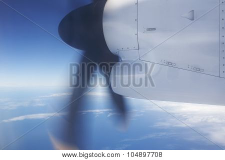 Aeroplane Flying Over The Ocean And Turbine Detail In Movement