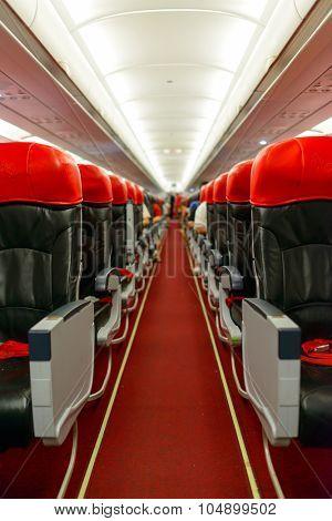 KUALA LUMPUR, MALAYSIA - MAY 02, 2014: AirAsia Airbus A320-200 interior. AirAsia Berhad is a Malaysian low-cost airline headquartered near Kuala Lumpur, Malaysia