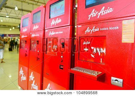KUALA LUMPUR, MALAYSIA - MAY 02, 2014:  AirAsia self check-in kiosks. AirAsia Berhad is a Malaysian low-cost airline headquartered near Kuala Lumpur, Malaysia