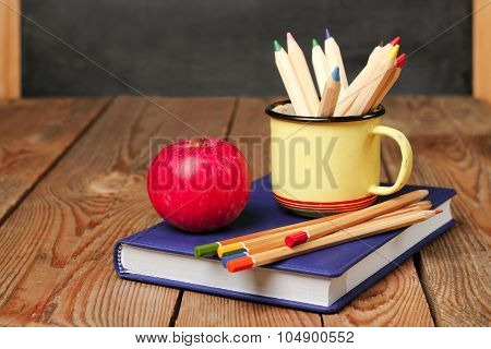 Pencils In A Mug, Book And Apple