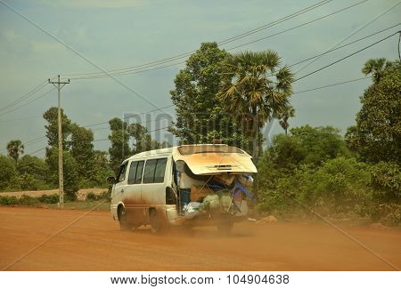 Truck Full Of Things On The Dusty Road
