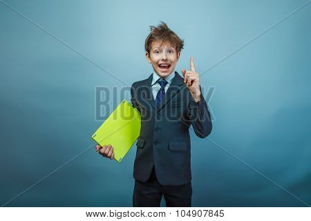 Teen boy businessman of European appearance with a shaggy head i