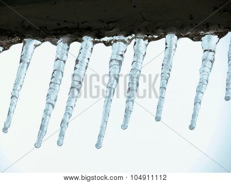 Icicles on the balcony of frozen winter