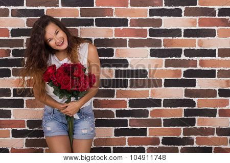 Yong Beautiful Girl Holding Roses And Smiling