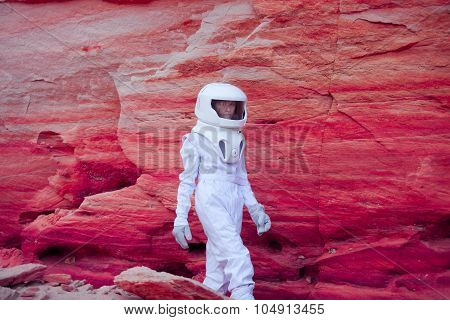 futuristic astronaut on crazy pink planet, image with the effect of toning