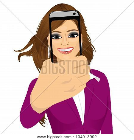 happy woman taking a selfie using her smartphone