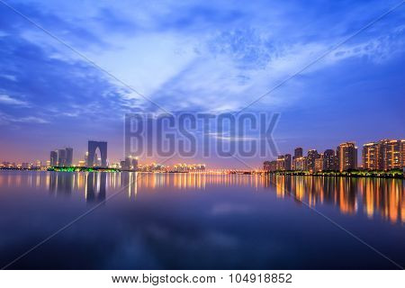 the surface of the river at dusk with metropolis