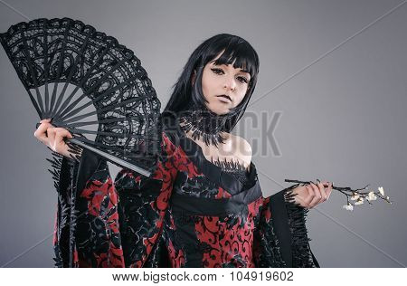 Sexy lady with hand fan