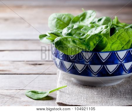 Baby spinach in a blue ceramic bowl