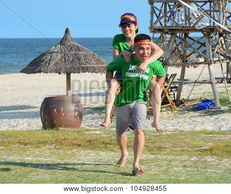 Young Couple Having Fun On The Beach