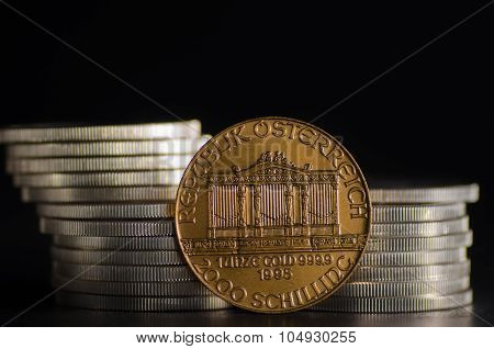 Austrian Philharmonic Gold Coin Infront Silver Coins