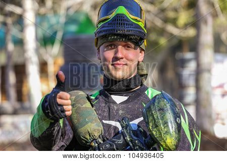 Smiling Paintball Sportsman Shows His Thumb
