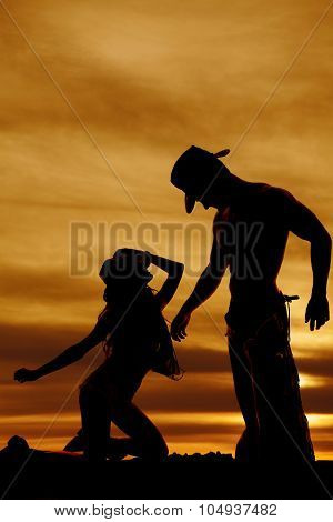 Silhouette Cowgirl Kneel Look Up At Cowboy