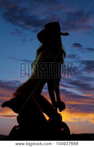Silhouette Cowgirl Kneel On Saddle