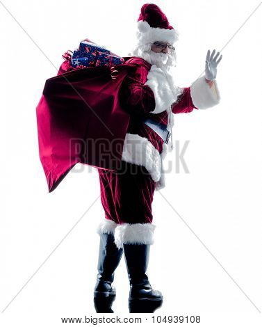 one santa claus man Saluting silhouette isolated on white background