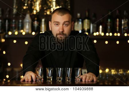 Portrait of handsome bartender at  work