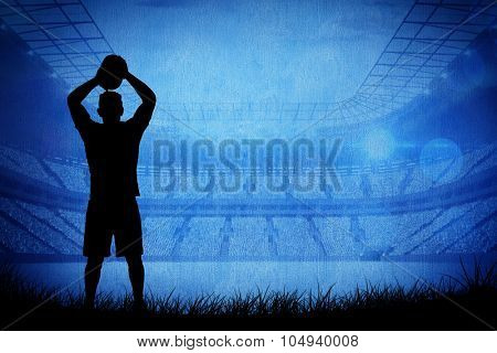 Silhouette of rugby player against rugby stadium