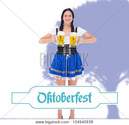 Pretty oktoberfest girl holding beer tankards against oktoberfest banner
