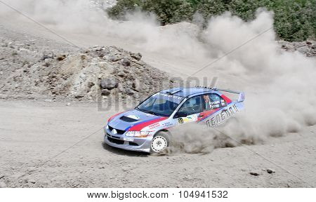 BAKAL, RUSSIA - JULY 9: Alexander Rogozin's Mitsubishi Lancer Evolution IX (No. 31) competes at the annual Rally Southern Ural on July 9, 2011 in Bakal, Satka district, Chelyabinsk region, Russia.