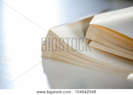 Closeup of stacked papers on table