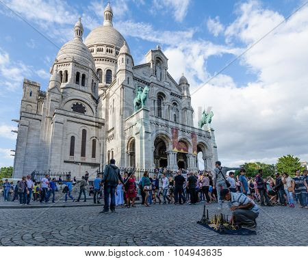 Souvenirs sold by male vendor at Sacre-Coeur Basilica