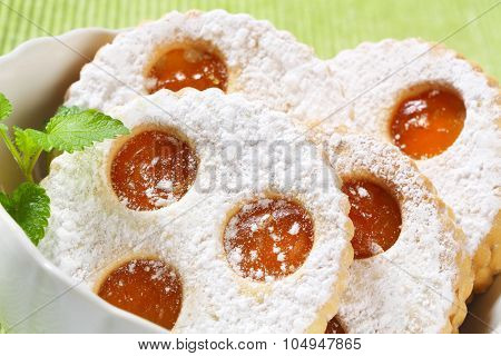 detail of linzer cookies with strawberry jam