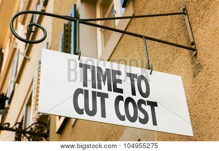 Time to Cut Cost sign in a conceptual image