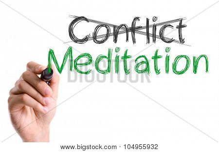 Hand with marker writing: Conflict Meditation