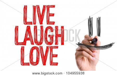 Hand with marker writing: Live Laugh Love