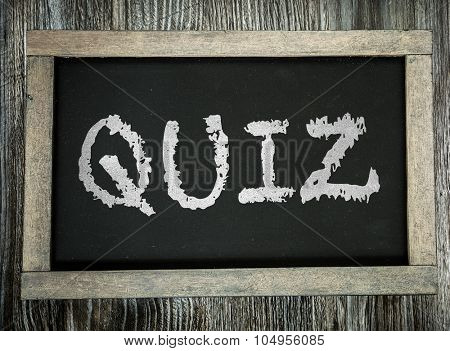 Quiz written on chalkboard