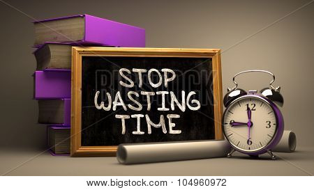 Stop Wasting Time - Motivational Quote on Chalkboard.