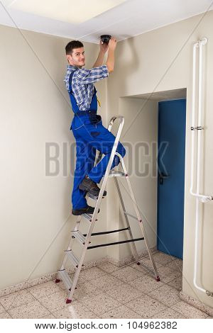 Technician Fitting Cctv Camera
