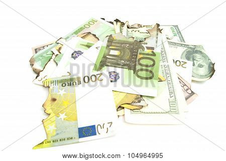 Some Burnt Bills Of Dollars And Euros On White
