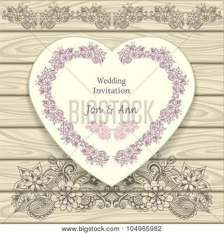 Wedding invitation in heart form  with doodle floral elements