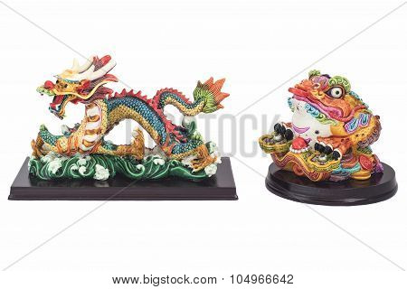 Figures of the Chinese dragon and a toad