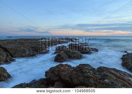 Sunset over the rocks at Shaws Cove in Laguna Beach