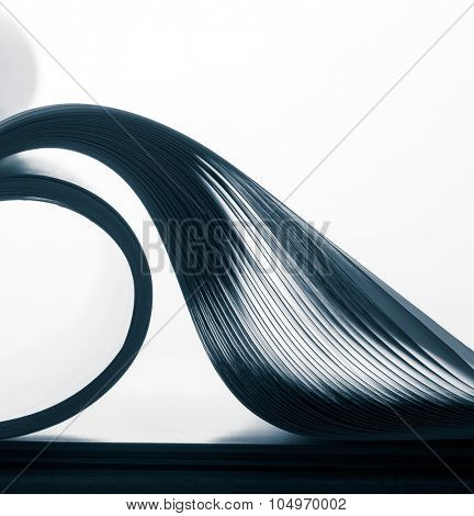 Paper sheets forming abstract curves against light