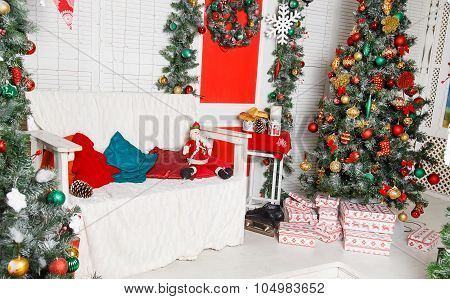Green Fir-tree With Red And Gold Christmas Toys With Sofa
