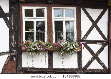 Window with flowers on a half-timbered house, Germany
