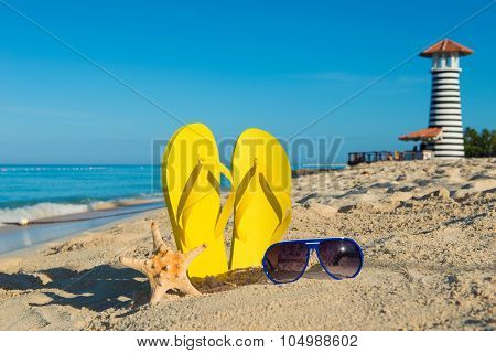 Trip To The Sea. Sunny Positive Beach Vacation. Yellow Sandals, Sunglasses, Starfish And Lighthouse
