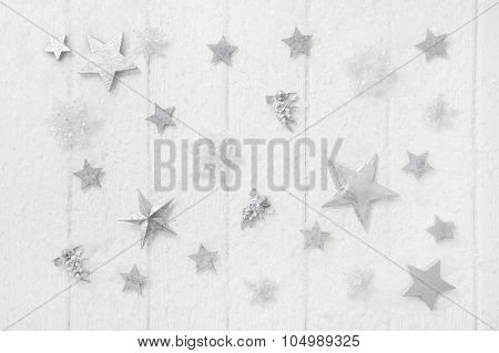 White snowy christmas background with stars and snowflakes on wood.