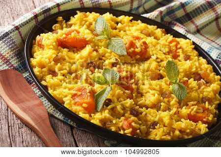 Vegetarian Pilaf With Saffron And Dried Fruit Close Up. Horizontal