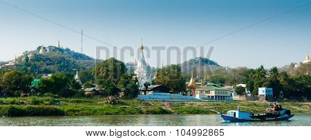 Boat On Irrawaddy River With Pagoda And Village