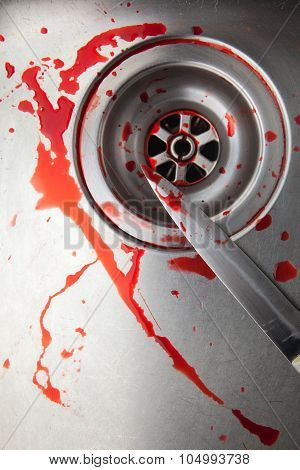 blood and knife in the sink