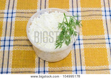 Container Of Cottage Cheese With Branch Of A Dill