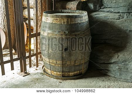 Old And Dilapidated Barrel In The Basement