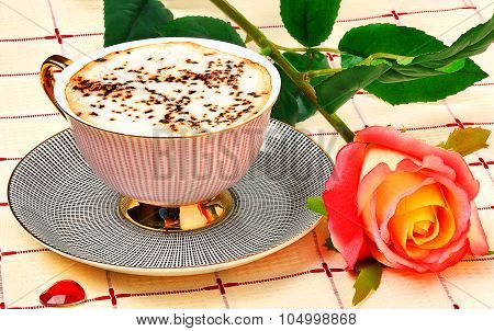 Cappuccino And Rose On Tablecloth