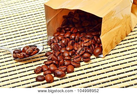 Coffee Beans On The Package On Tablecloth
